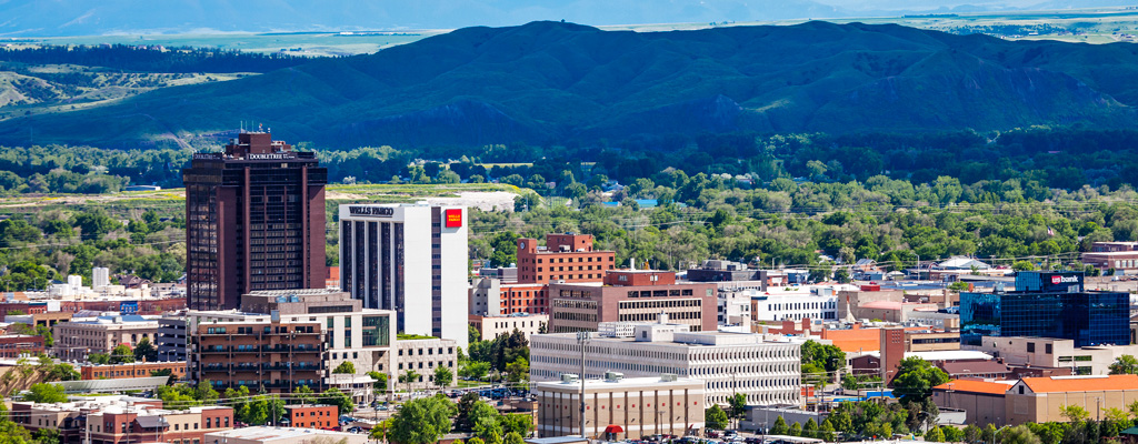 """Nestled beneath the towering sandstone cliffs of the Rims and along the banks of the mighty Yellowstone lies the largest city in Montana - Billings. With a burgeoning medical sector and booming oil industry, some call it a regional hub for commerce. We hope you'll call it """"home."""""""